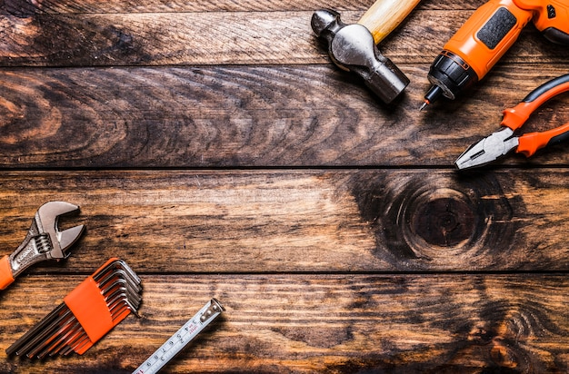 High angle view of various worktools on wooden background