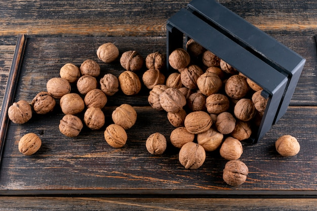 High angle view walnuts from black box on wooden horizontal