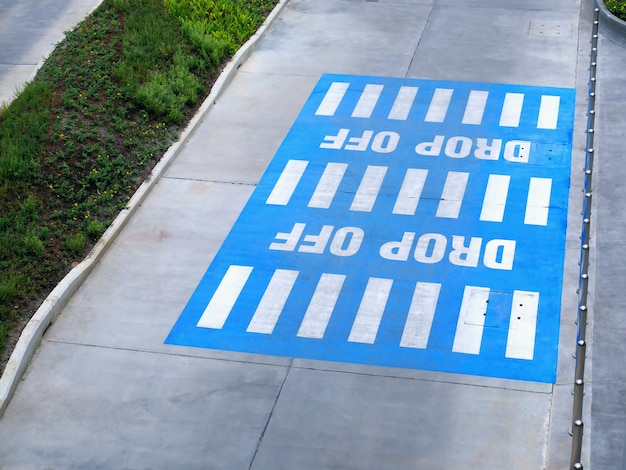 High angle view of white drop off texts on blue rectangular area