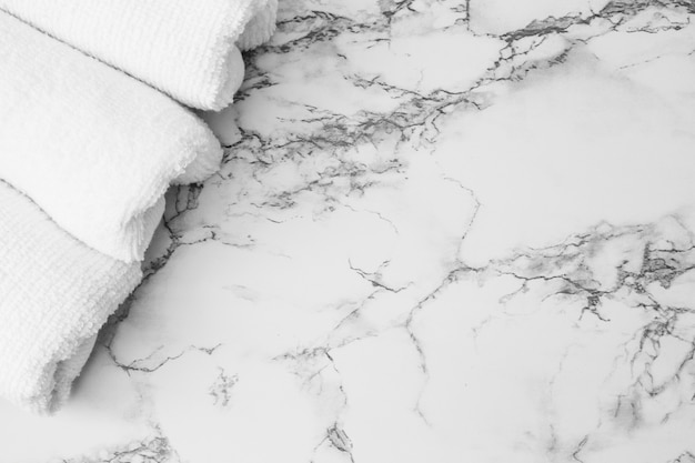 High angle view of white towels on marble backdrop