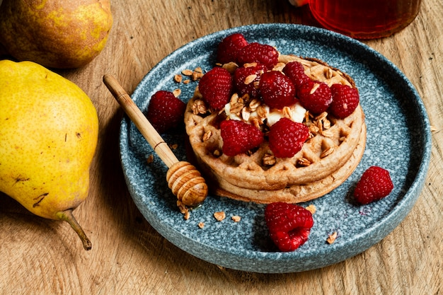 High angle waffles with raspberries oats and honey