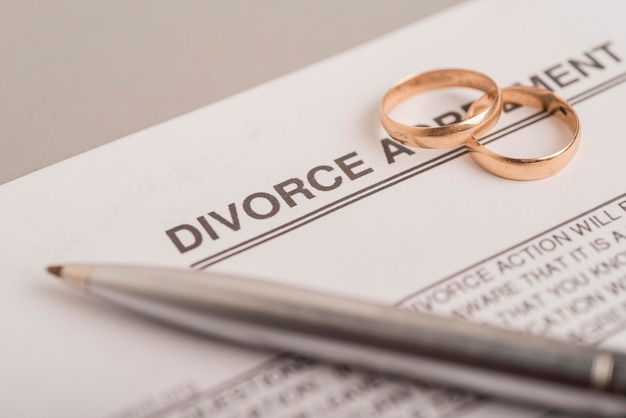 High angle wedding rings on agreement