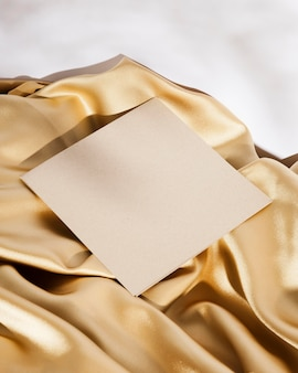 High angle white card on golden cloth