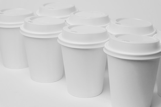High angle white cups with caps
