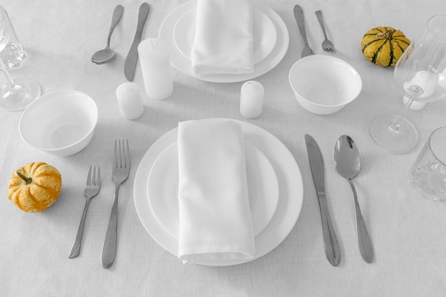 High angle of white plates on table with copy space