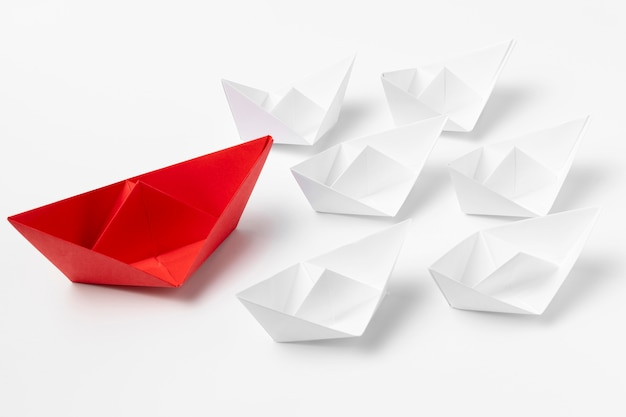 High angle white and red paper boats