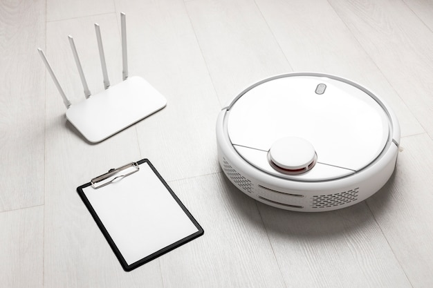 High angle of wi-fi router with vacuum cleaner and clipboard