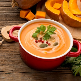 High angle of winter squash soup with parsley in bowl