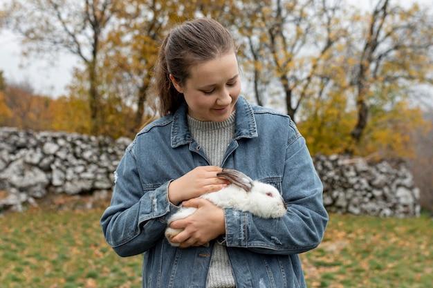 High angle woman caring rabbit