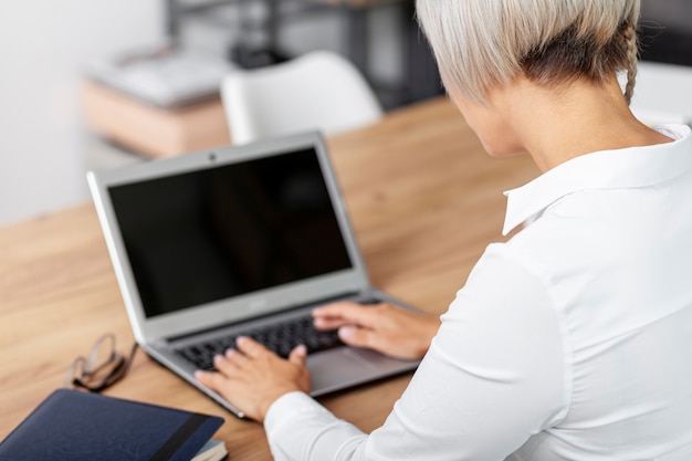High angle woman at office working