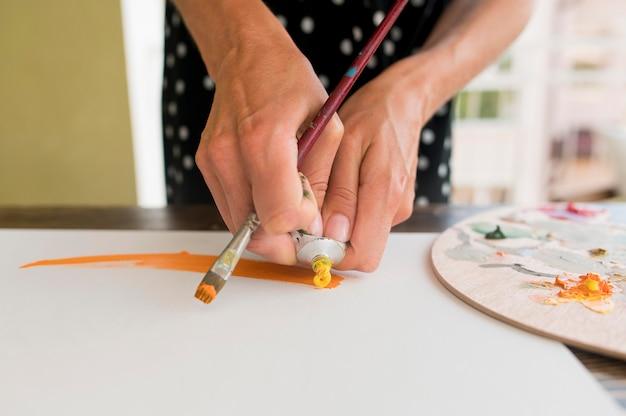 High angle of woman painting canvas