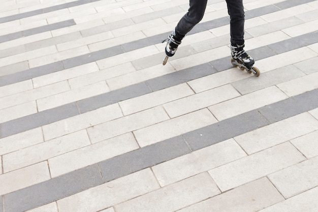 High angle of woman in roller blades with copy space