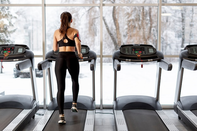 High angle woman running on treadmill