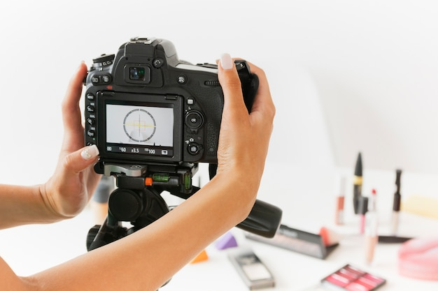 High angle woman setting camera to record