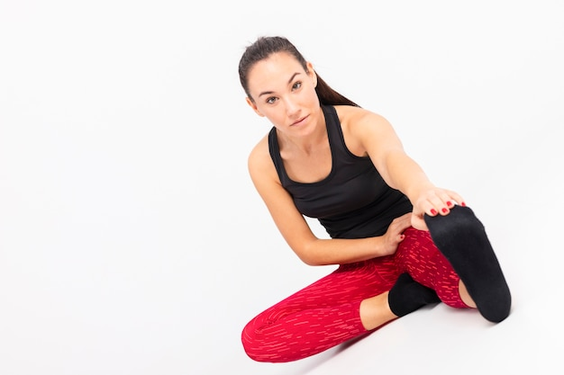 High angle woman stretching body