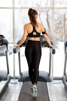High angle woman training on treadmill