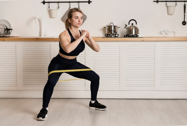 High angle woman training with elastic band