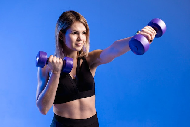 High angle woman training with weights