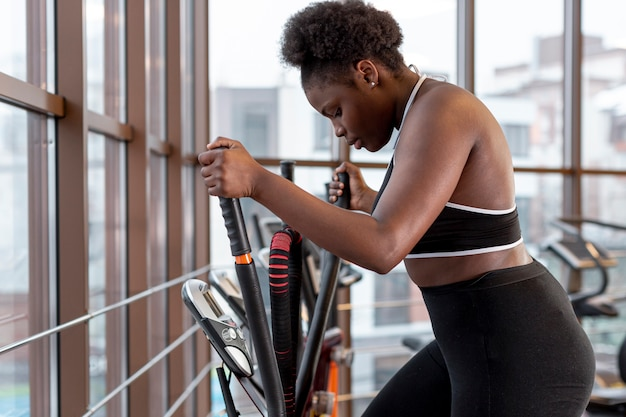 High angle woman on treadmill at gym