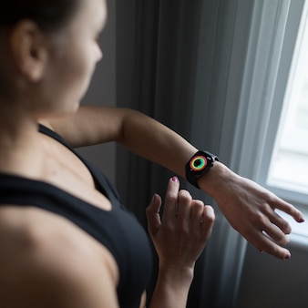 High angle of woman using her smartwatch