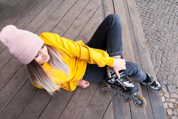High angle of woman with beanie in roller blades