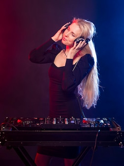 High angle woman with headphones mixing