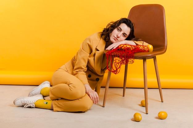 High angle woman with lemons