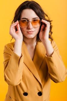 High angle woman with sunglasses