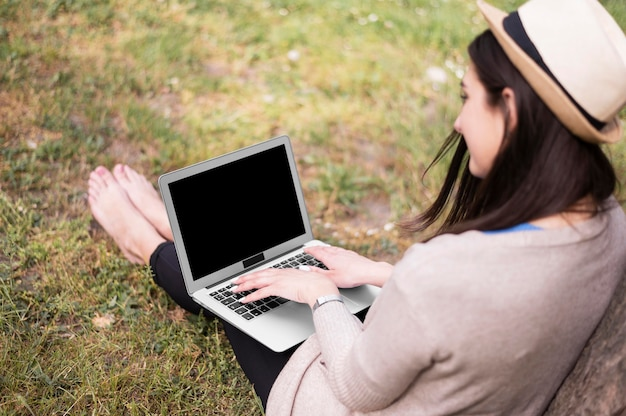 High angle of woman working on laptop outside