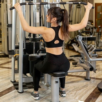 High angle woman working out at gym