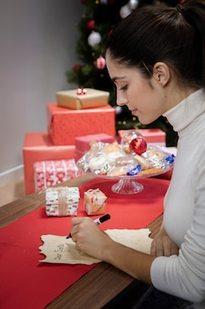 High angle woman writing letter for santa claus