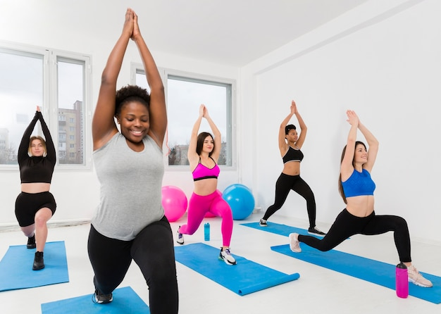 High angle women exercising on mat