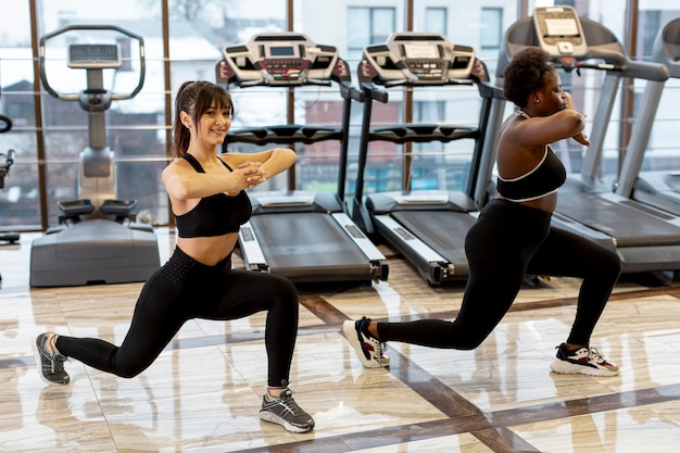 High angle women at gym working out together