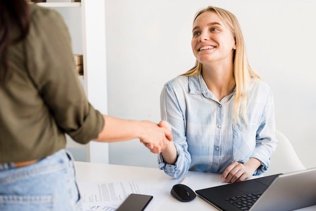 High angle womens shaking hands
