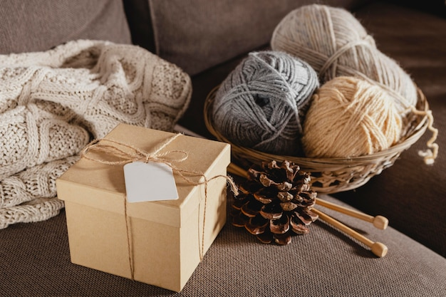 High angle wooden box with yarn and pine cone