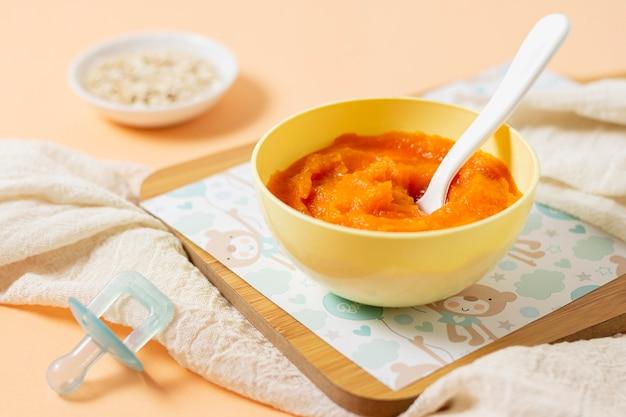 High angle yellow bowl with baby food