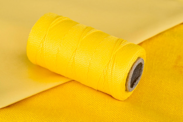 High angle of yellow thread roll