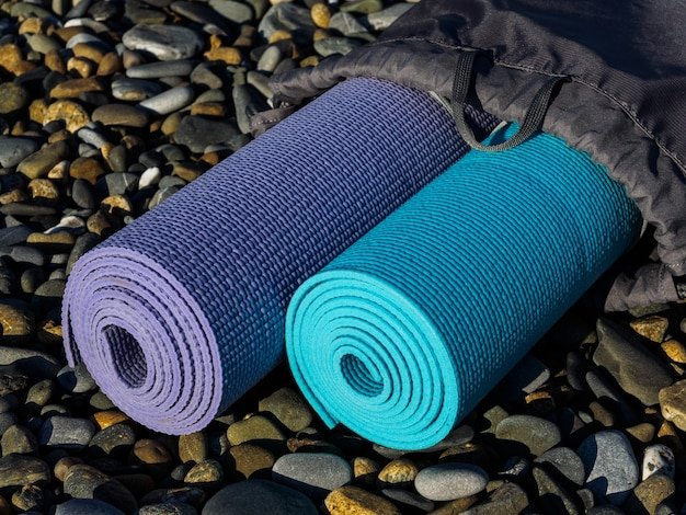 High angle of yoga mats on sea rocks