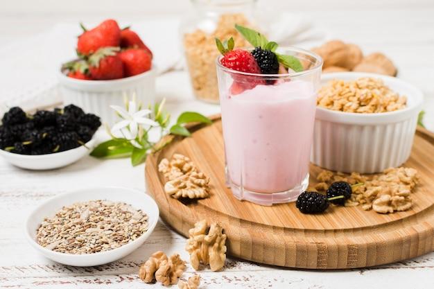 High angle of yoghurt glass with fruits