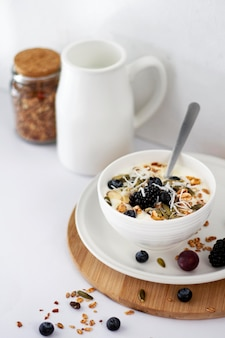 High angle yogurt bowl with fruits and cereals