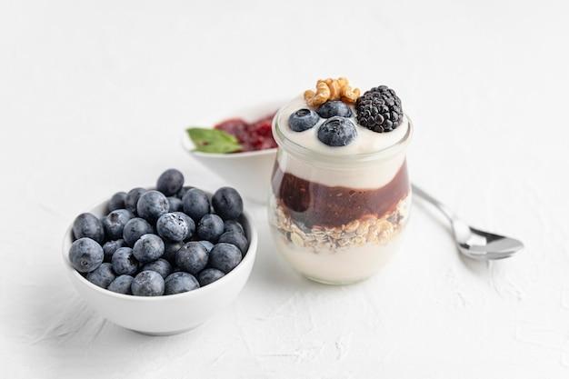 High angle yogurt with blueberries, jam and oats