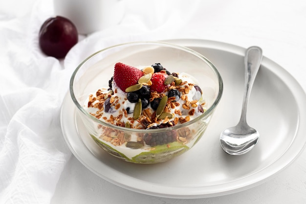 High angle yogurt with cereals and fruits