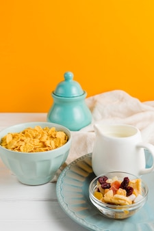 High angle yogurt with dried fruits and cornflakes