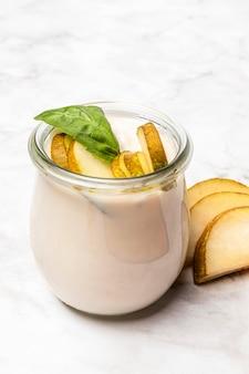 High angle yogurt with pear