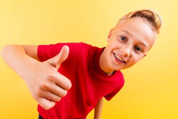 High angle young boy showing ok sign