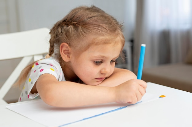 High angle young girl drawing