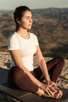 High angle young woman meditating