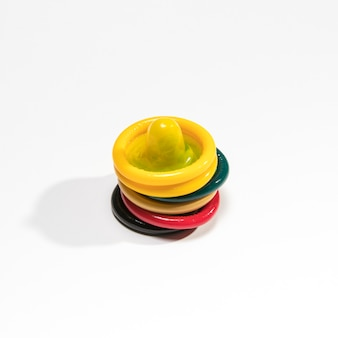 High angles colourful condoms on white background