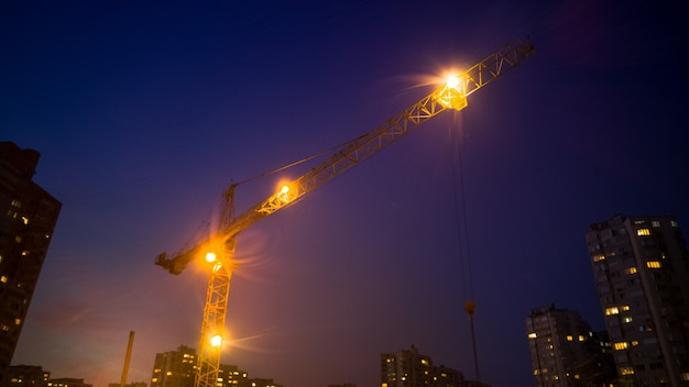 High building crane working at night