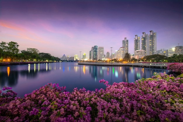 High business building behind the river in the park at beautiful night bangkok thailand